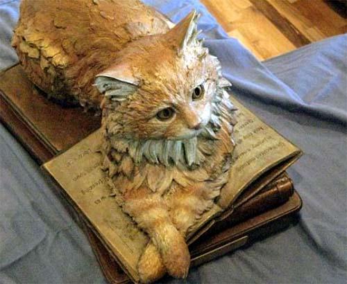 dewey em bronze - Os gatos e sua inusitada atração por livros